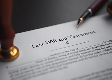 Photo of a last will and testament with a seal and fountain pen